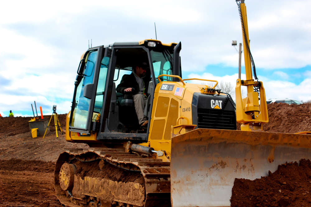 Paul Cook of Tilcon sees for himself how he can doze more in less time with Trimble 3D technology outfitted on this Cat D5K2 dozer.