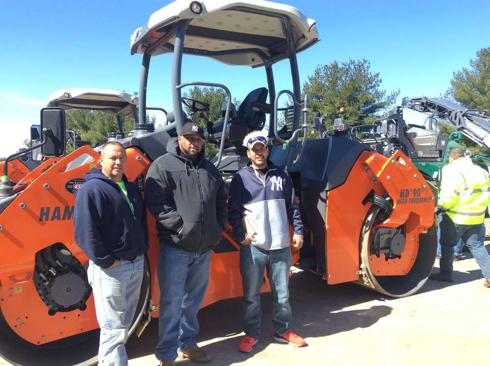 (L-R): Bill Ockenfels, operator; Mike Wright, driver; and George Colon Jr., driver/technician, all of Bozzutos, Cheshire, Conn., are ready to test the Hamm HD+90i tandem roller.