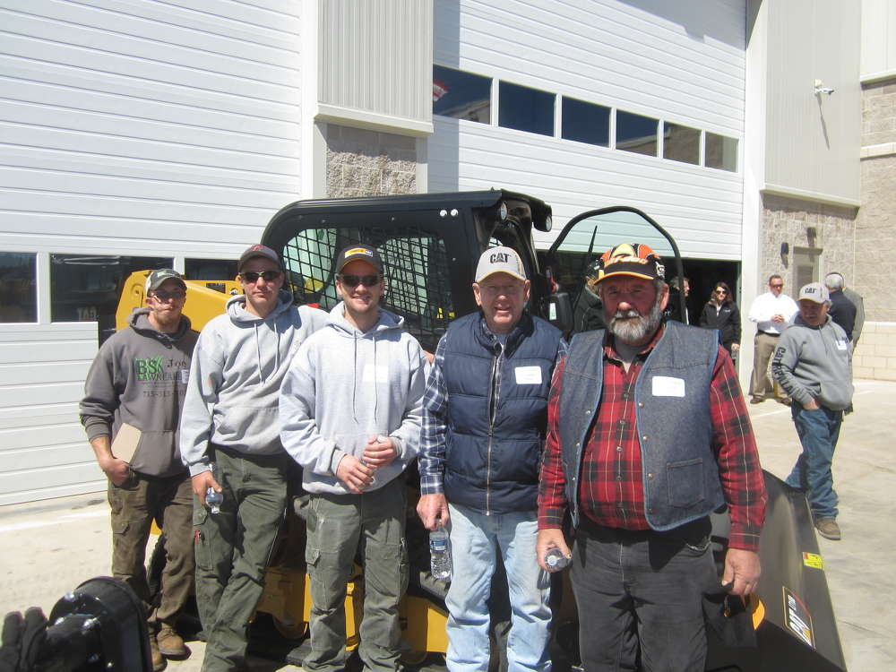 (L-R): Joseph Gilles, Josh Chrusciel and Blake Pozarski, all of B.S. Lawn Care, and Tom and Harold Kempen, both of Backyard Stone, enjoy their time at Fabick CAT's Season Opener in Eau Claire