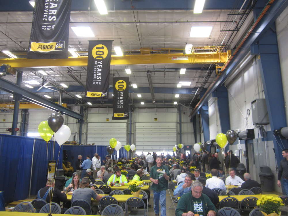 Customers enjoy a barbeque lunch in the shop area of the Eau Claire, Wis., facility.