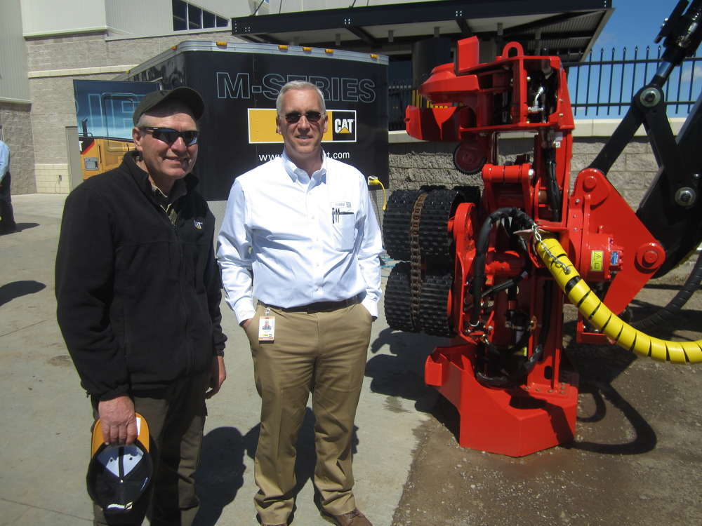 Steve Hemshrot (L) of Johnson Family Forestry speaks with Cory Vrolijk of Fabick CAT about the PF48 processing head.