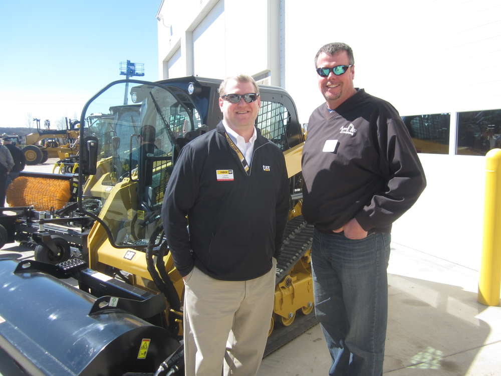 Loren LaGesse (L), Fabick CAT, shows the outside equipment display area to Dean Amys of Amys Excavating.