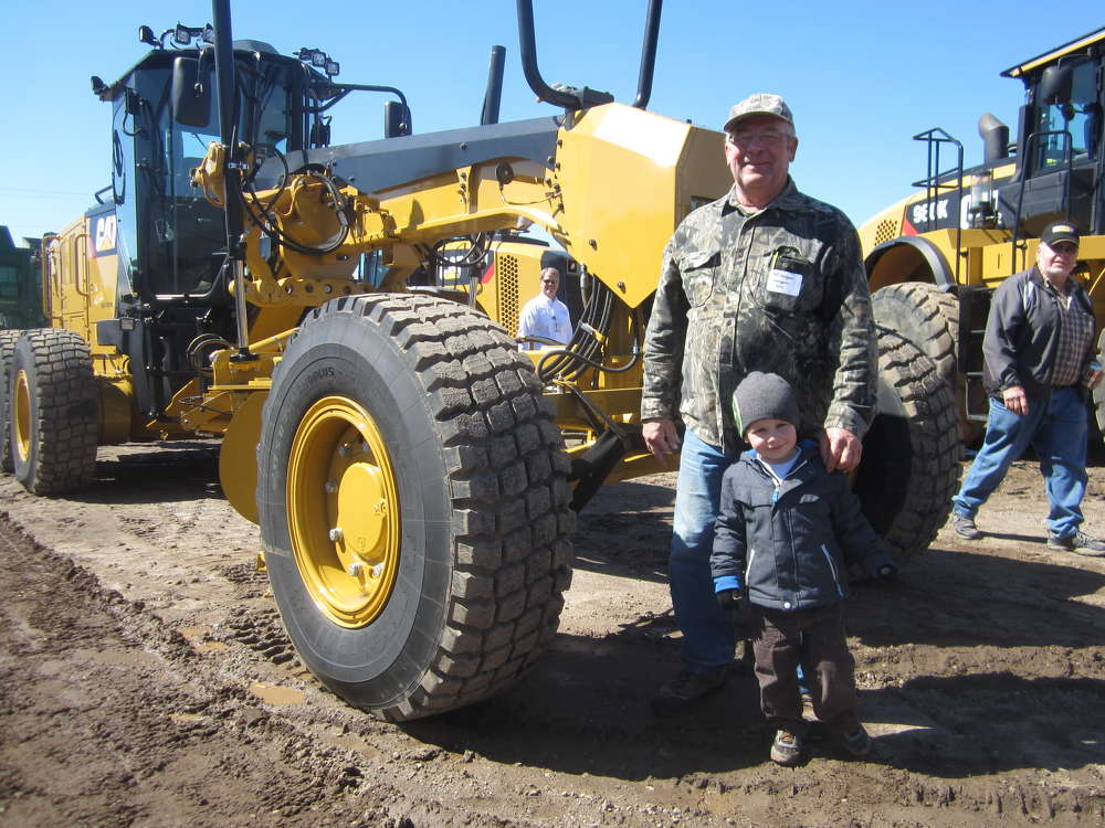 Bill Groepper of Groepper Excavating brought his grandson, Trenton, to the open house to look at all the big Cat machines.