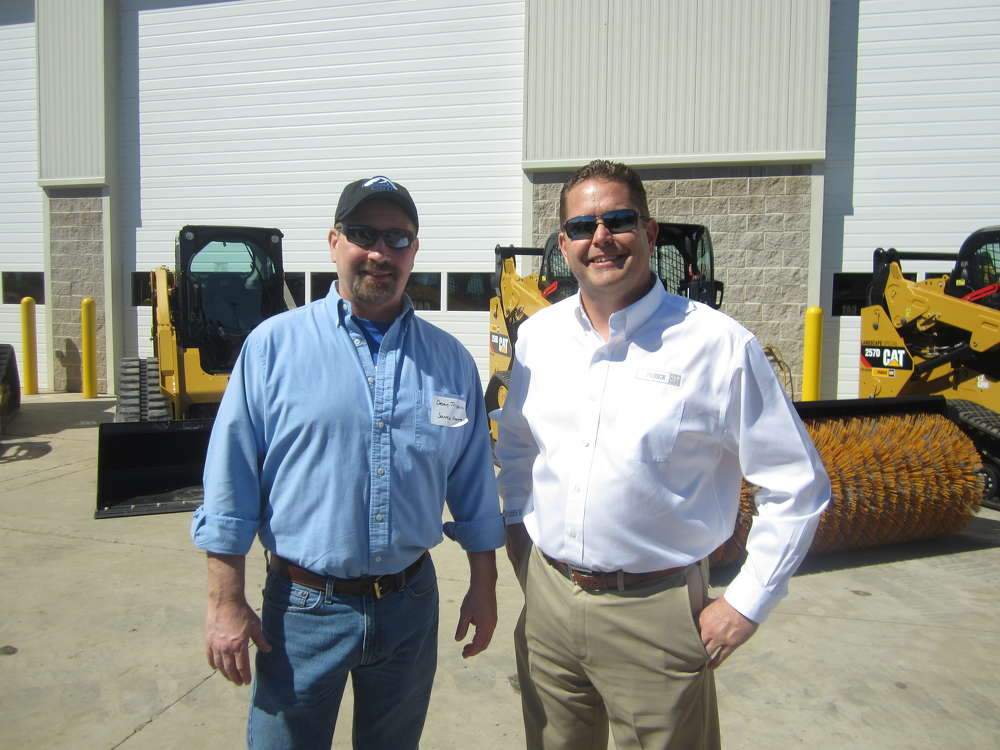 Dean Trippler (L) of Source Energy Services receives a warm welcome from Jim Sands, Fabick CAT, at the open house.