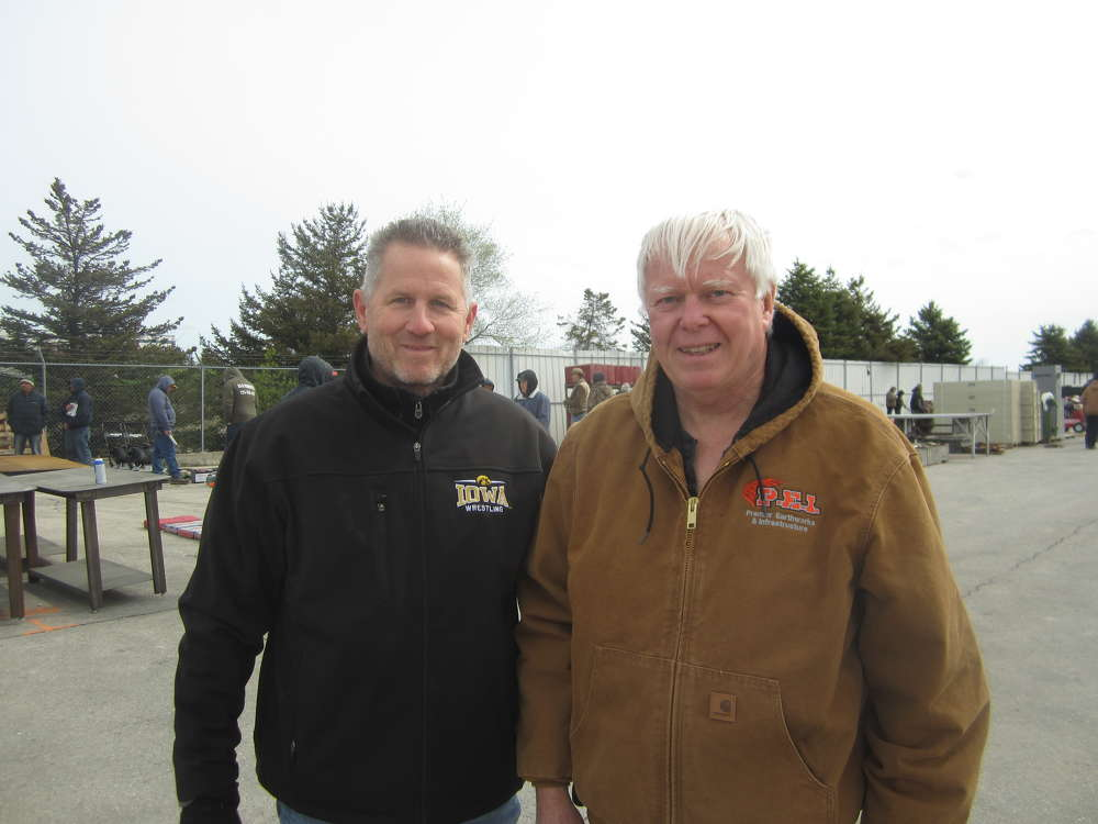 Bud Pecoy (L), Mid Country Machinery Inc., and Art Bayley, 1st Source Bank, attend the auction.