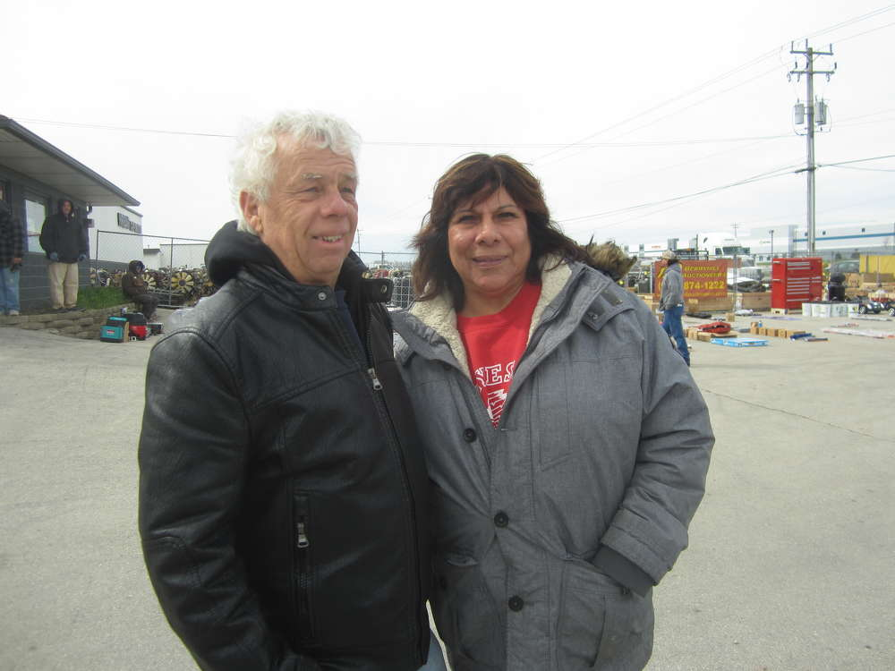 Norm Manthe (L), Northwest Equipment & Trailer, and Tina Boyt enjoy their time at the auction.