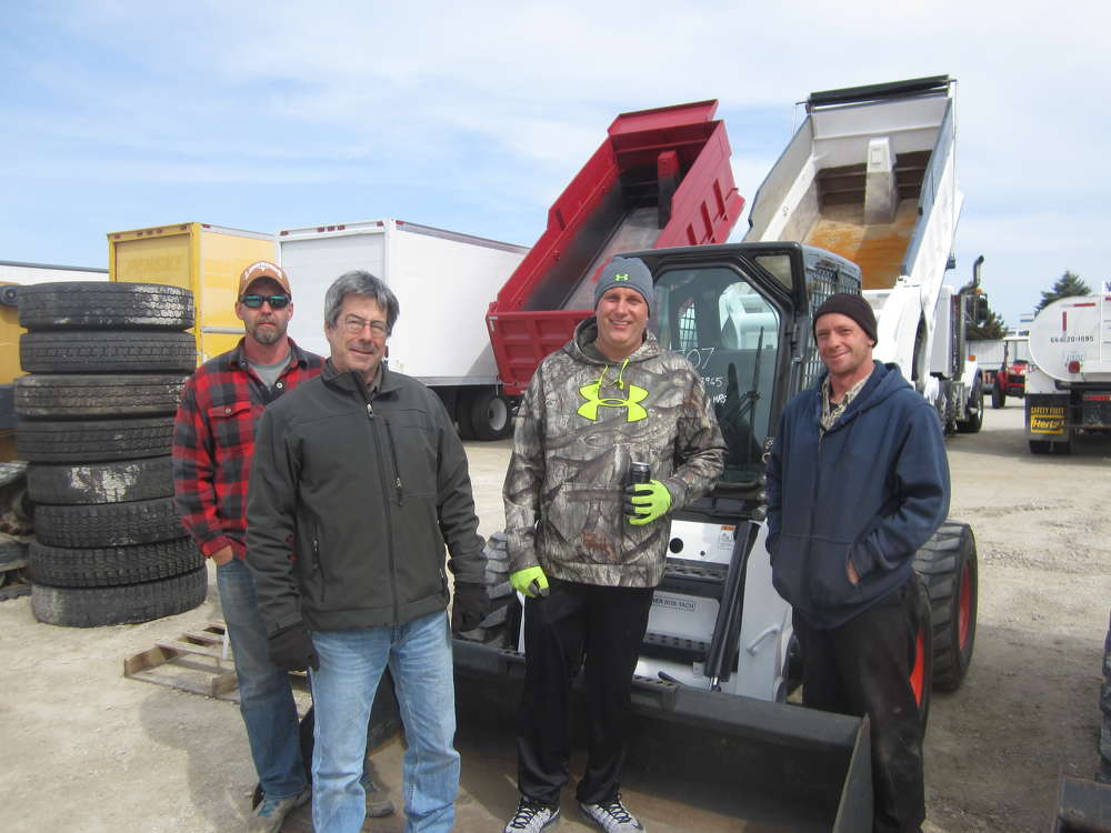 (L-R): Adam Heinson, Jelly Stone Park; Jeff Knepper, Five Star Services Inc.; Steve Bigelow, Elite Electrical Co.; and Tom Mateljan, Five Star Services Inc., look over the skid steers at the April 29 auciton.