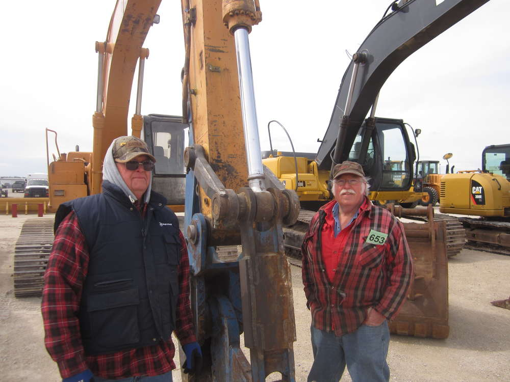 Russell Schuchaskie (L) of Schuchaskie Construction and Fred Mlados of Fred's Repair & Fabrication check the stick of this Case 9030 excavator.