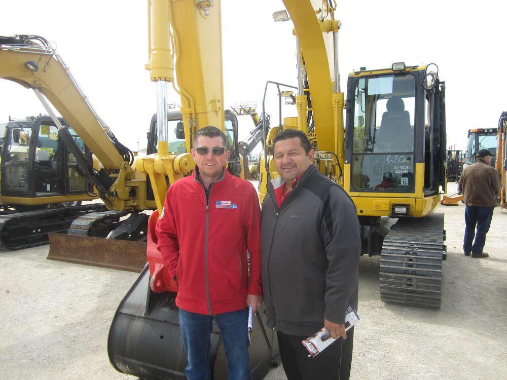 Simon Bradley (L), U.S. Equipment Sales & Rentals, talks with and John Avelar of J. Ave Development.