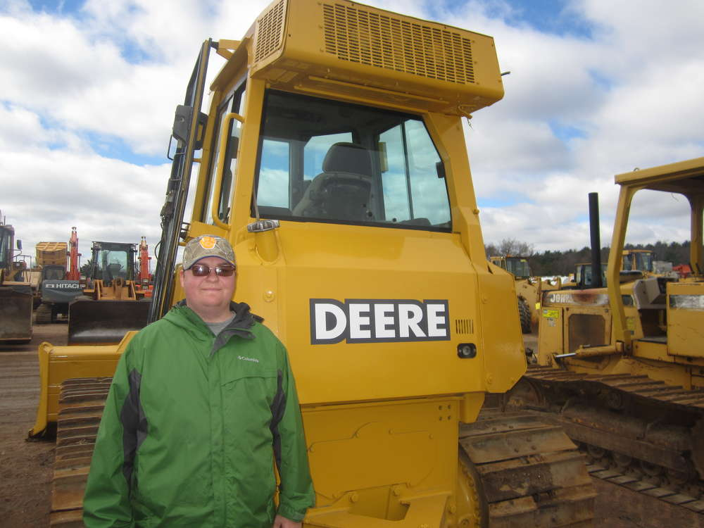 Tyler Kurth shops at the auction yard and stops to see this John Deere 700 dozer.