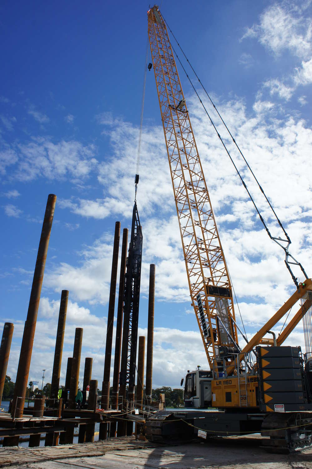 """FDOT? photo """"The large Liebherr crawler cranes can be seen at almost every interchange, and are being used for pile driving and structure work when the work space allows,"""" said Jon Walker, SGL program project manager."""