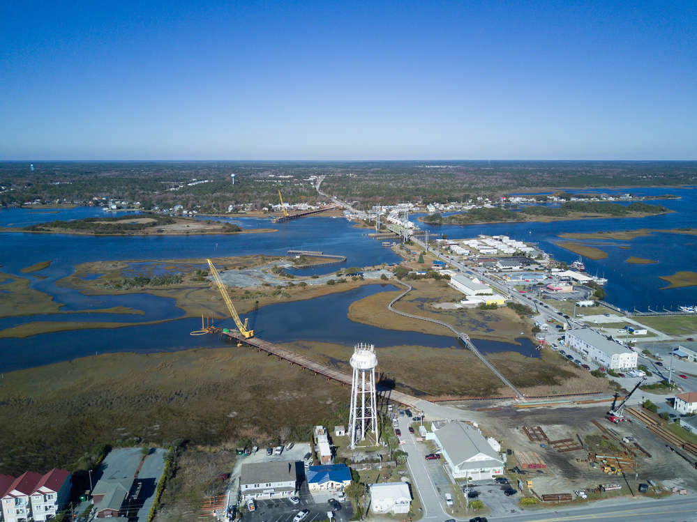Work is in its early months on a sparkling new bridge being built across the Intracoastal Waterway along the southeast North Carolina coast at Surf City.
