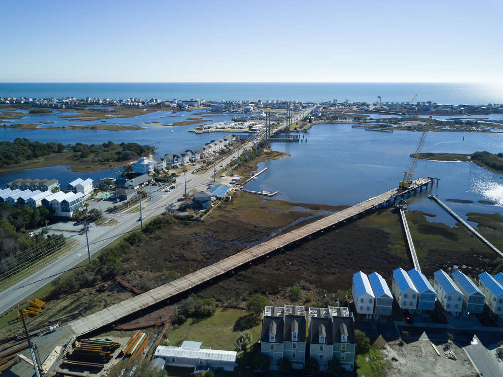 The $54 million project is intended to replace an aging swing bridge, but because of its elegant design, it also will give motorists, bicyclists and pedestrians a sweeping view of the ocean as they come into town