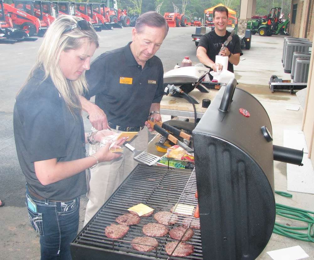 (L-R): Tiffany Rogers, sales; Larry Freeman, Atlanta JCB manager; and Steve Obermeyer, assembly and maintenance technician, man the grill at the event.