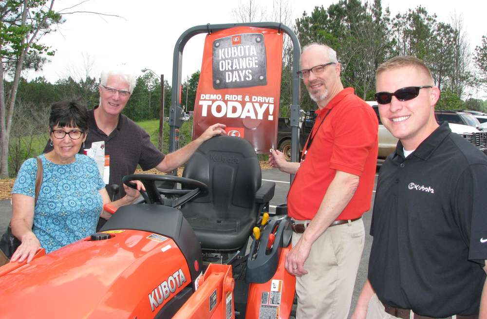 (L-R)): Pat and Andy Wilson, business owners in the Atlanta area, talk with Ken McGuffin, Atlanta Kubota, and Hank Thacker of Kubota Corporation.