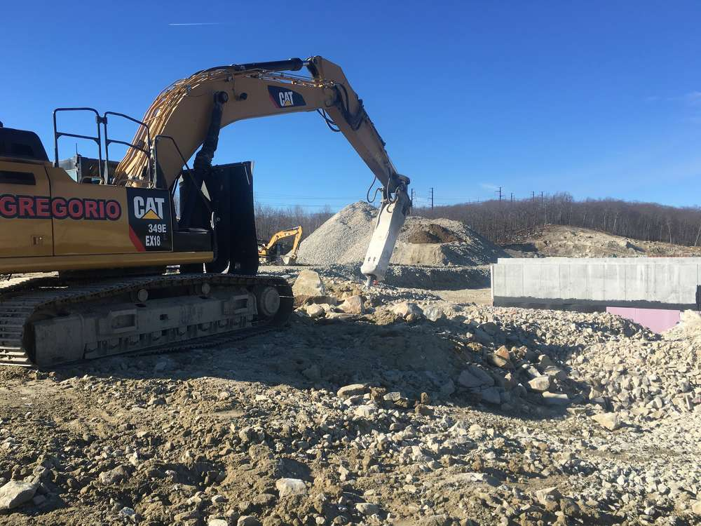 Crews had to remove the existing landfill and blast bedrock, which required large quantities of explosives to prepare the land for construction.