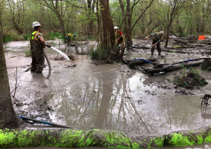 Workers assess a spill by Rover Pipeline affecting approximately 500,000 square feet of wetlands on April 27, 2017 in Stark County, Ohio. File Ohio EPA