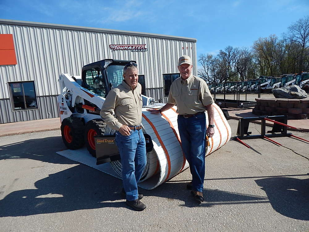 Gary Ringus (L), president of SlatTrax,  Plymouth, Minn., and Mike Peschel, sales of SlatTrax, showcase the SlatTrax XL-42-in. with a 100 feet of rollable underlayment support system  that can be attached to additional rolls.
