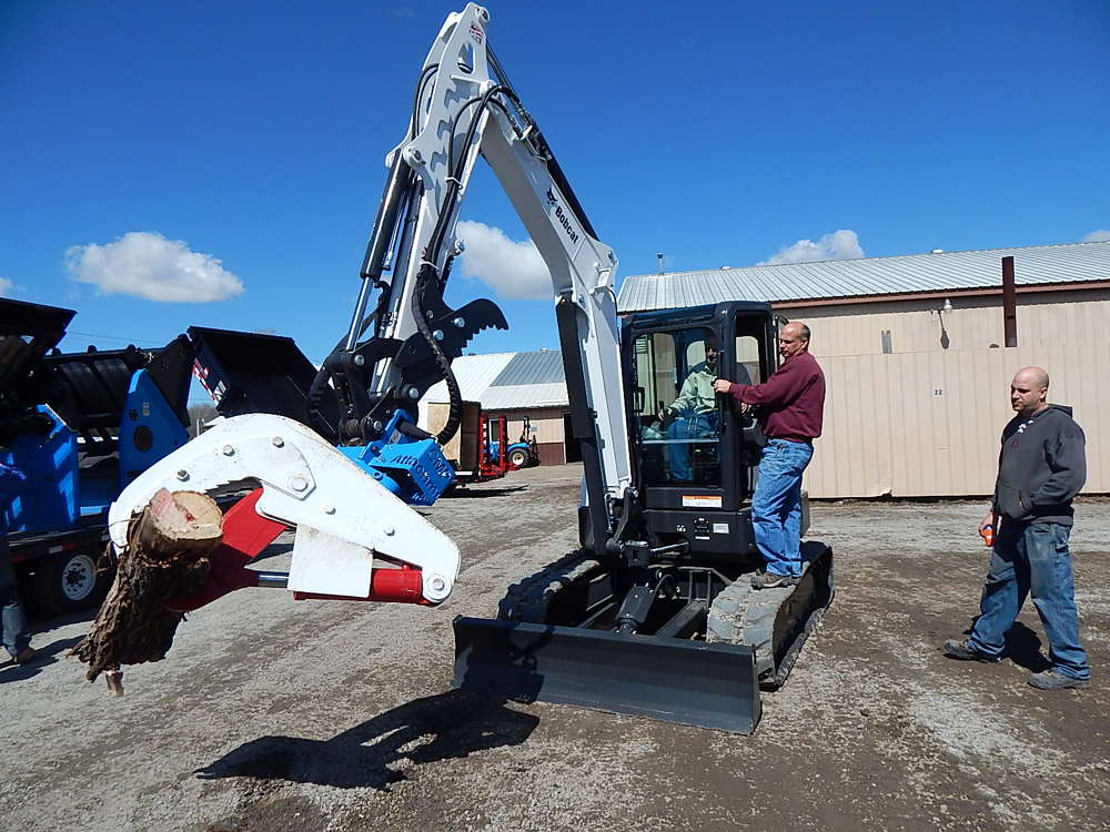 Mark Kunkel (L), Farm-Rite sales representative, demos a Bobcat E55 excavator with CMP Attachments of Becker, Minn., for Mark Prom of Alpine Cabinetry, St. Cloud, Minn.