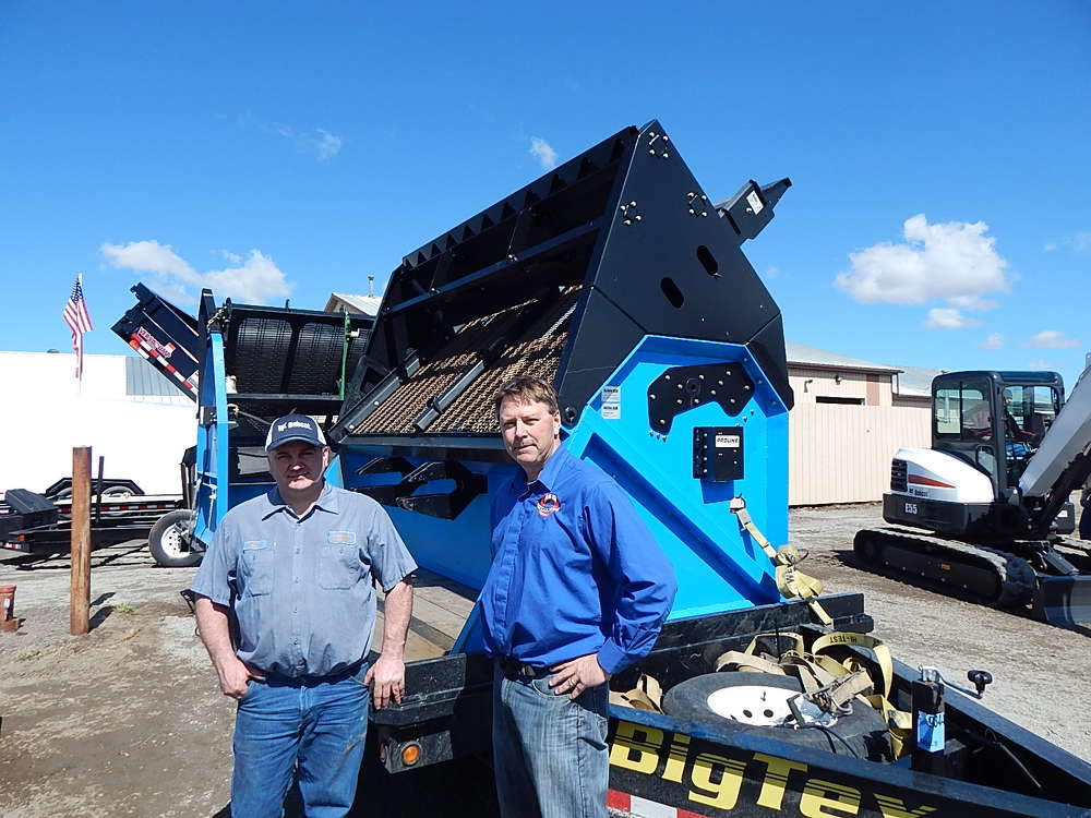 Mark Ratka (L), Farm-Rite service manager, and  Jeff Meyer, Abra Equipment Supplies, attend the open house.
