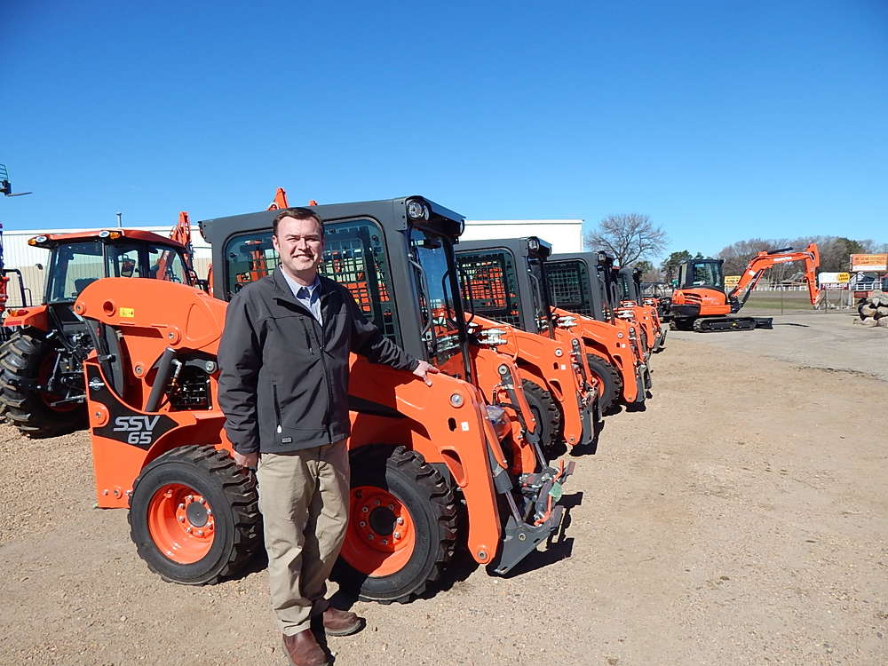 Paul Kroening, regional sales manager, Kubota Fort Worth, Texas, stands with the extensive Kubota product lines available at Lano Equipment.