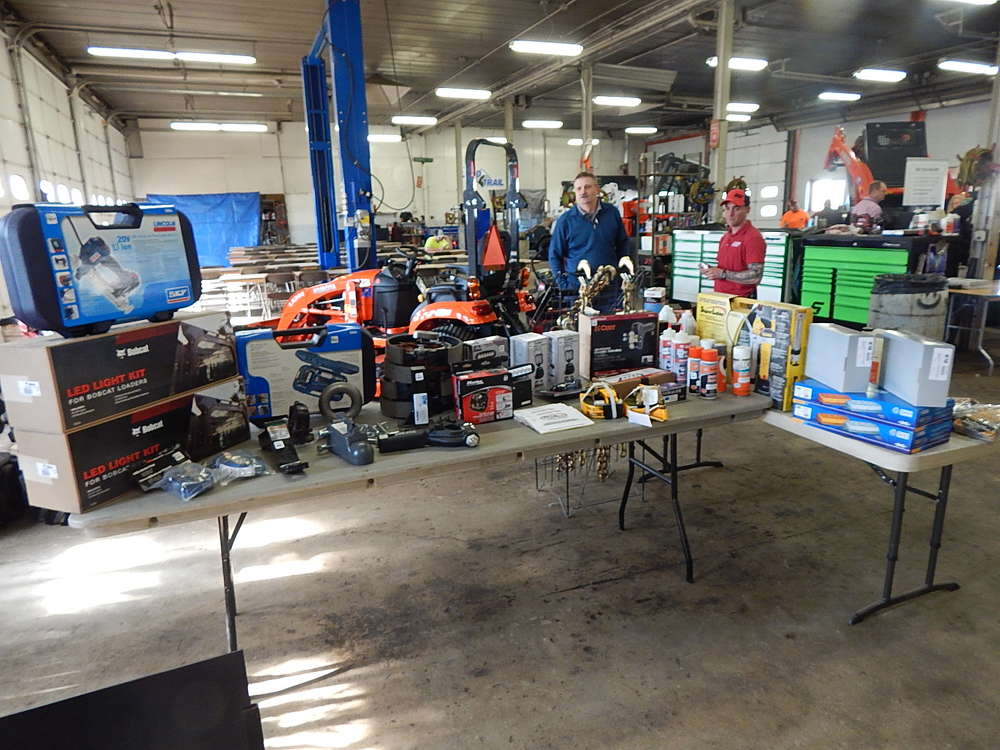Eric Grube, district service manager, Bobcat Company, West Fargo, N.D., looks over the massive prize table with Andy Cutts, head technician.