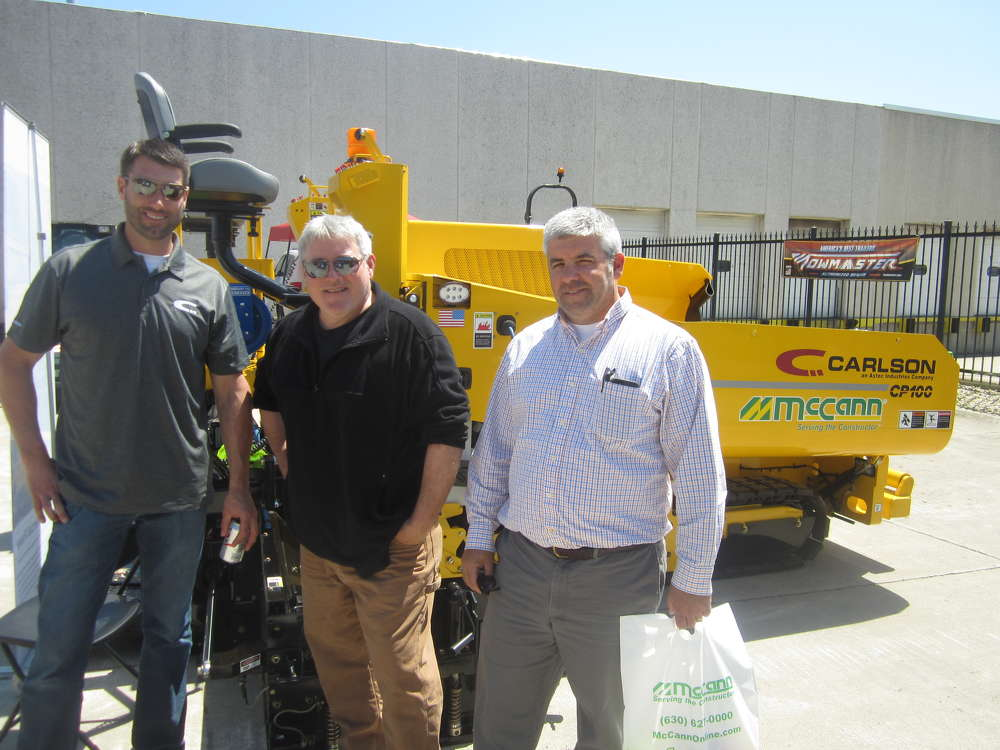 (L-R): Kevin Jeske, Carlson Pavers representative, answers questions about the line now available at McCann Industries from Tom Duffy and Michael Gilliam, both of Abbey Paving.