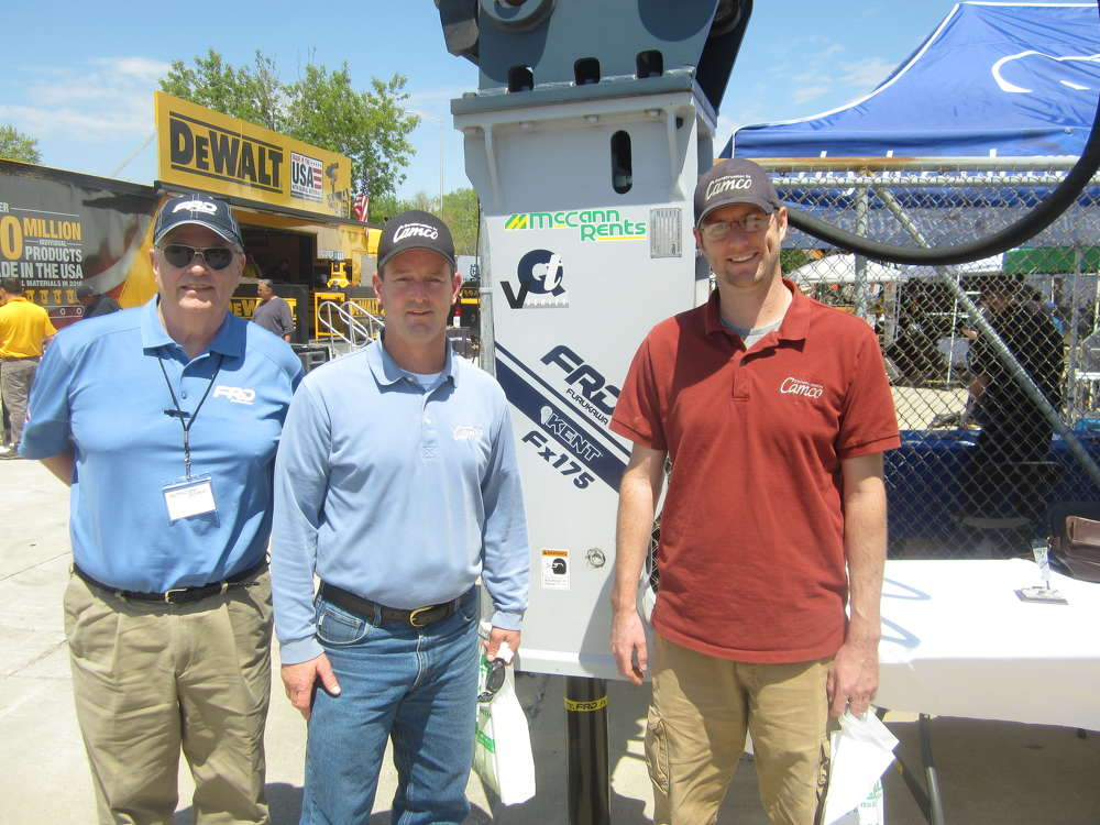 (L-R): Tim Carroll of FRD Furukawa speaks with Mike and Andy Marchiniak, both of Construction By Camco, about the FRD Furukawa FX175 hammer.