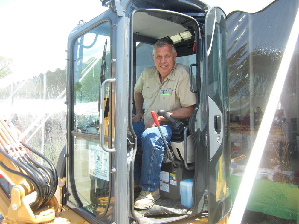 Duane Billingsley, Creative Homes and More LLC, sits in the cab of this Case CX31B mini-excavator.