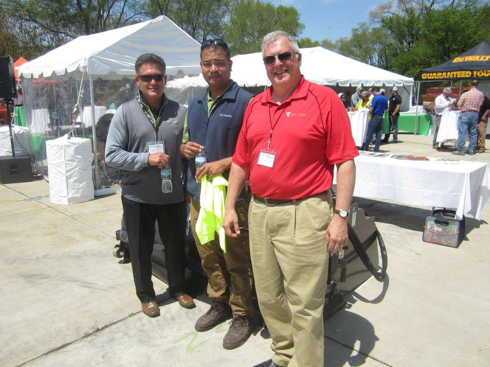 (L-R) are Dennis Tovar, McCann Industries Inc., Sam Kukadia, MSL Inc., and Tim Murphy of Paladin Attachments.