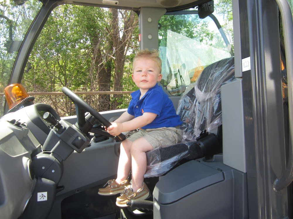 Future heavy equipment operator James Brusveen takes the wheel of this Case 221F wheel loader. James is the grandson of McCann Industries director Dennis Kruepke.