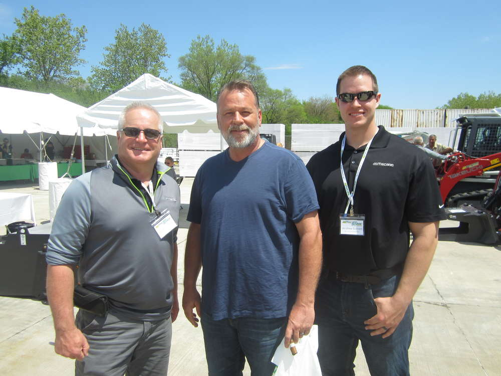(L-R): Steve Costello, McCann Industries Inc., Tim White, TRW LLC, and Andrew Somers, McCann Industries Inc., have fun at the pig roast and open house.