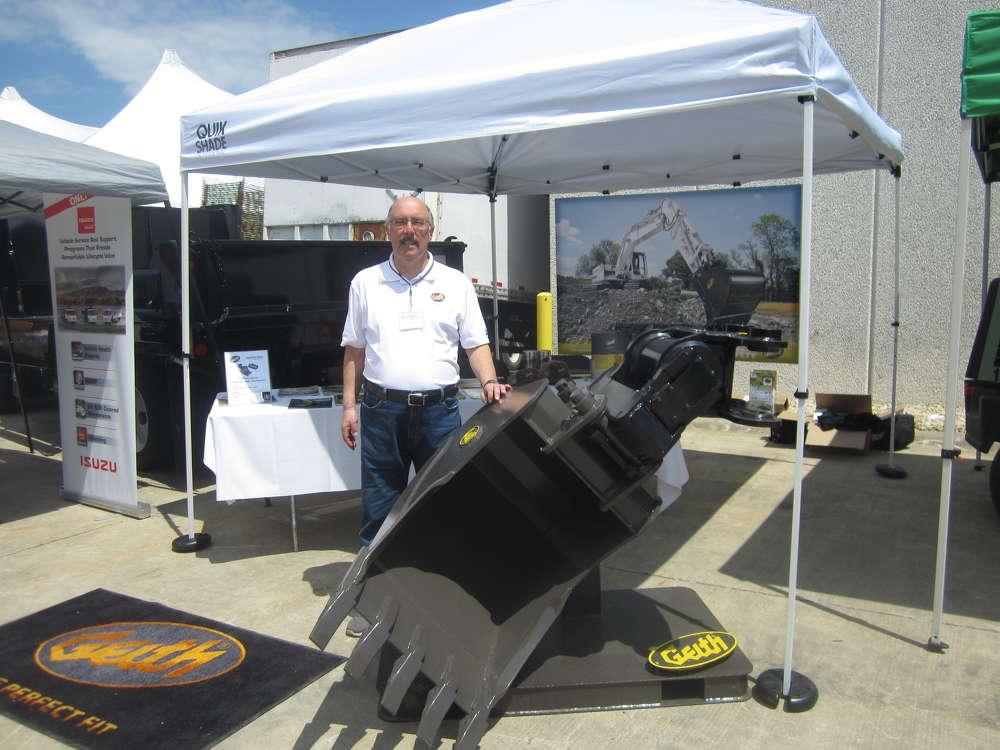 Mark Shear of Geith Attachments showcases the Geith tilting coupler with a 30-in. heavy-duty bucket.
