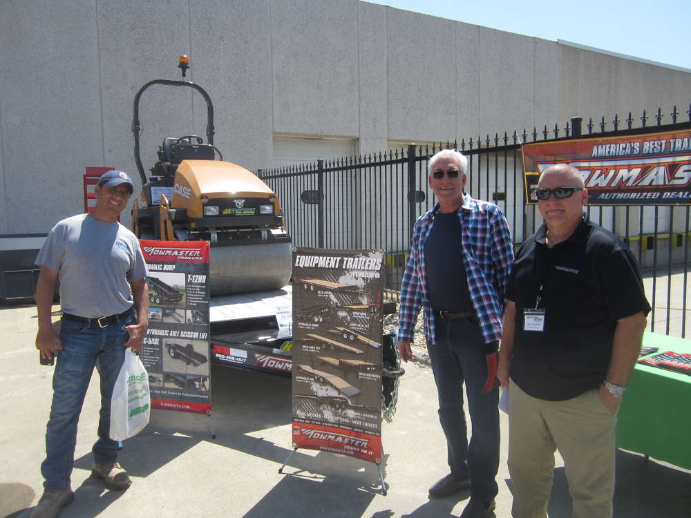 (L-R): Dino Bauaro and Steve Spine, both of Royal Concrete Specialties, visit with Russ Woelke, Towmaster Trailers, at the pig roast.