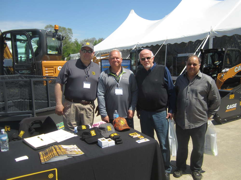 (L-R): Rich Windbiel, Rockland Manufacturing, and Ray Sullivan, McCann Industries Inc., go over the Rockland Manufacturing buckets and dozer blades with Mike Thompson and Dominic Fiordirosa, both of Archon Construction Co. Inc.
