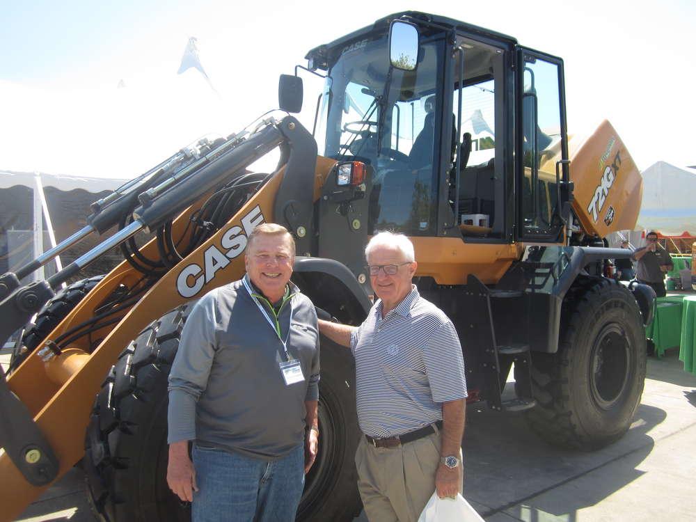Dennis Kruepke (L), director of McCann Industries Inc., and Bob Paszczak, chairman of Wheaton Bank , enjoy the pig roast to celebrate the 50th anniversary of McCann Industries Inc.