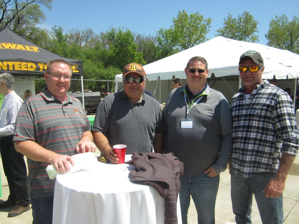 (L-R) are Marty Nelsen and Rainy Abrego, both of Everest Excavating; JR Boerner, McCann Industries Inc.; and Jason Greve, Everest Excavating.