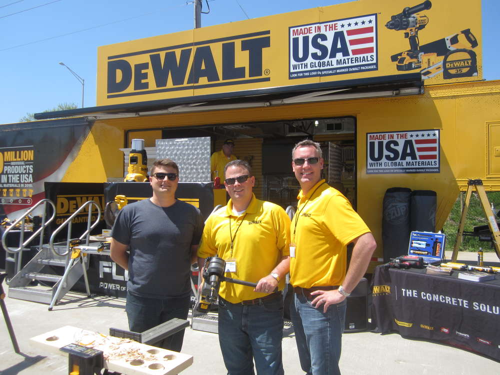 (L-R): Greg Voirin of MSL Inc. stops by the DeWALT booth to check out a demonstration by Peter Gerosa and Dan Gilligan, both of DeWALT.