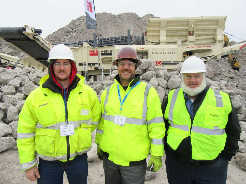 (L-R): Andy Kirby of Kirby Sand & Gravel joins Chris Toigo, AGGCORP, and Frank Kirby, also of Kirby Sand & Gravel, to check out a live demonstration of this MDS M515 rip rap tracked trommel.