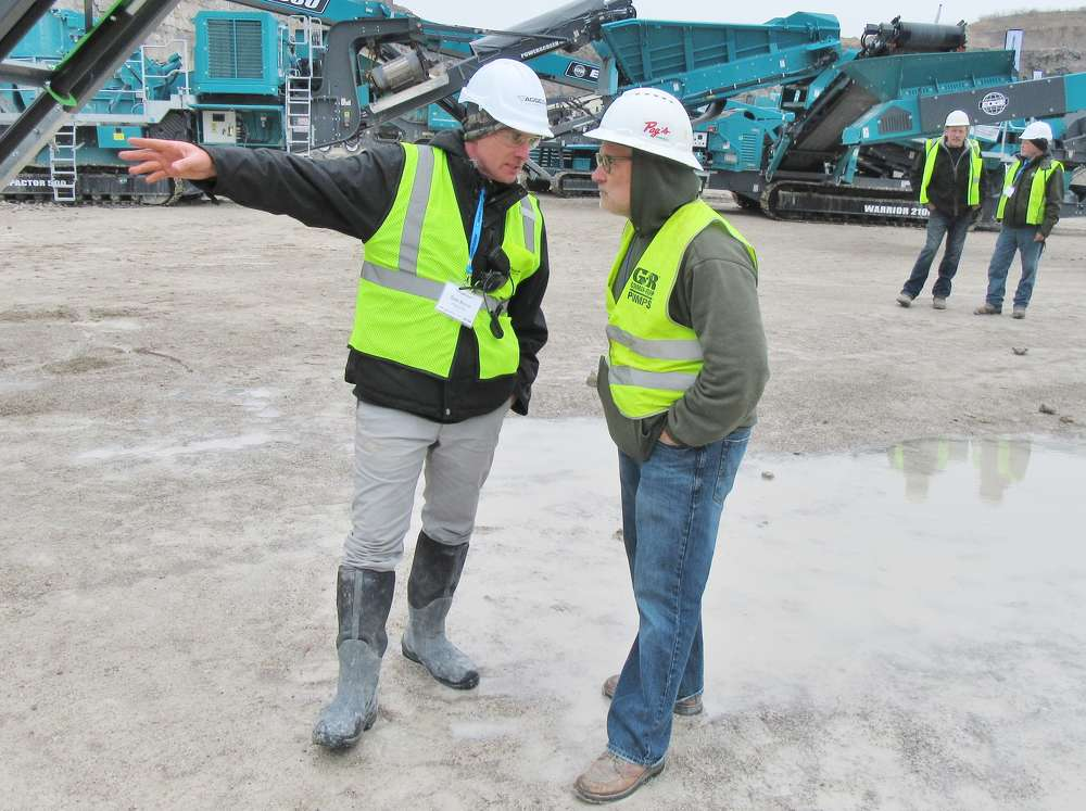 Sean McIvor (L), owner, AGGCORP Equipment Systems, talks with Marty Pagnucco of Pag's Excavating.