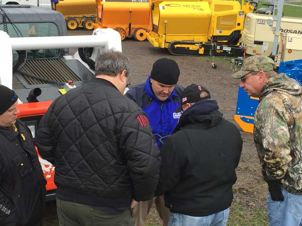 Adam Drumheller, product support manager, and Justin Bloss, service manager, showed customers how to operate the Bobcat skid loader.