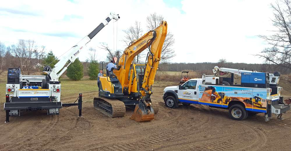 Harter equipment service personnel assist a customer on the job site.