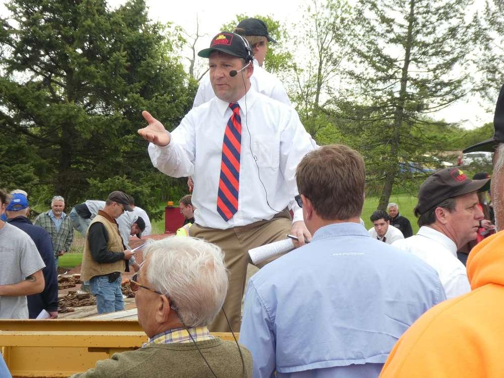 Tim Dewey of Hunyady Auction Company takes bids on a 35-ton Trail King trailer.