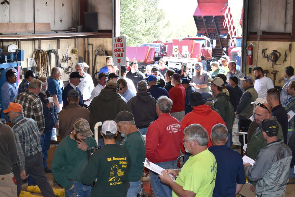 Bidders gather around to vie for some of the indoor items during the auction
