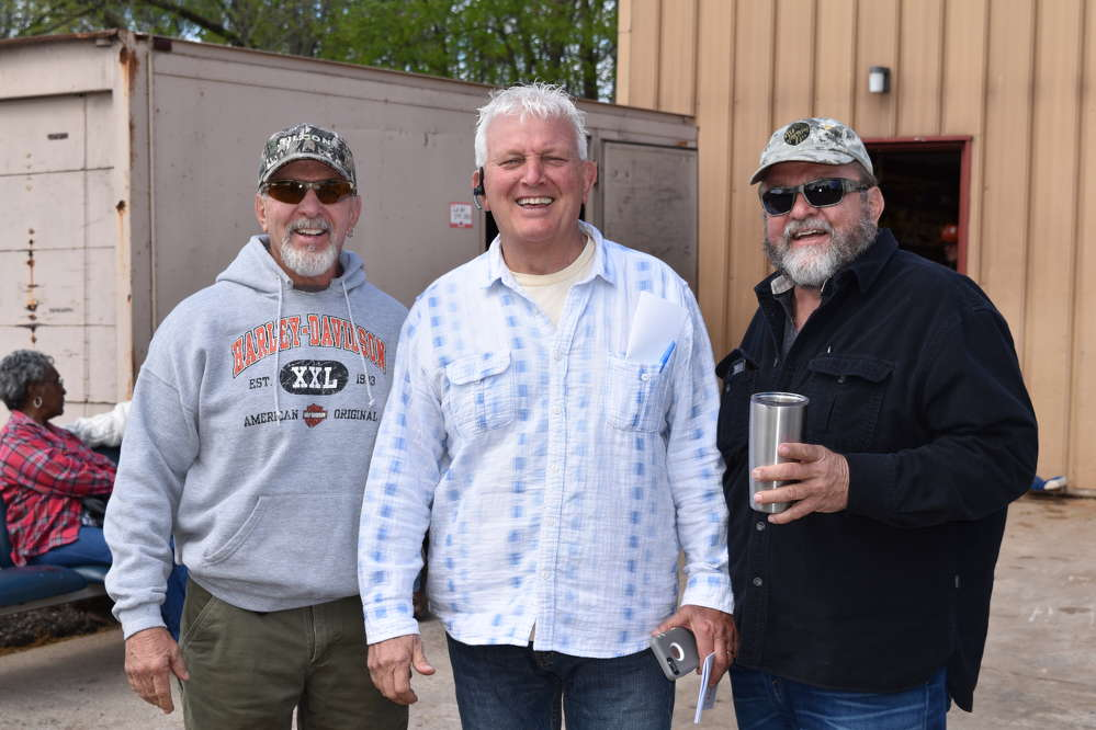 (L-R): Mark, Brian and Wayne Barbiche are all smiles as their retirement auction takes place in their equipment lot. Congratulations to the Barbiche Brothers on their retirement
