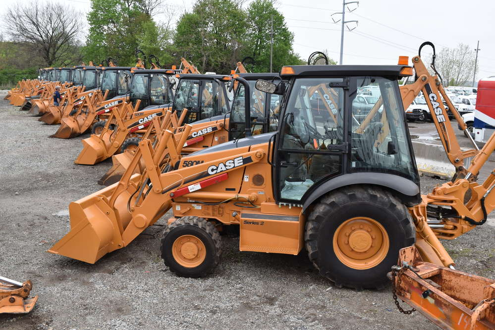 Case backhoes are lined up and ready to go to the highest bidder.