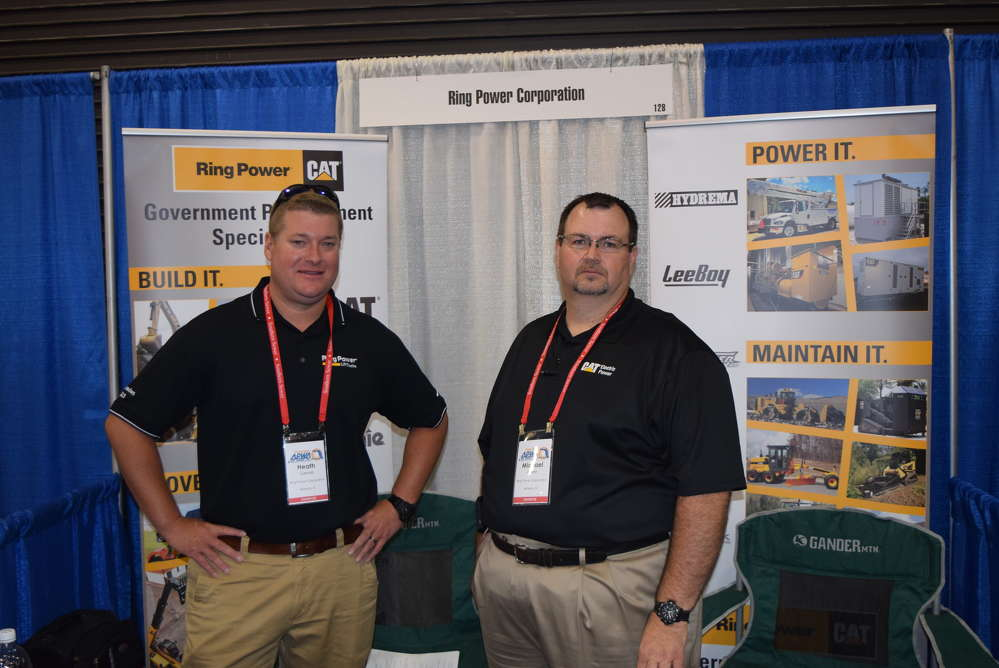 Heath Gerrell (L) and Mike Acree, both of Ring Power, discuss the products and services that Ring Power has to offer.