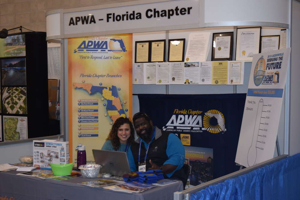 Kelsey Cox (L) and Jamie Brown answer questions for the APWA attendees and exhibitors.