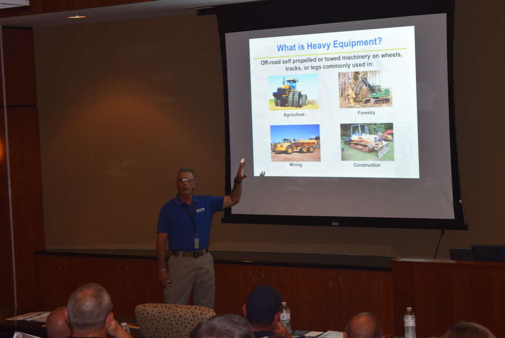 Herb Price, NICB special agent, Southeast region, educates law enforcement attendees about the various pieces of heavy equipment.