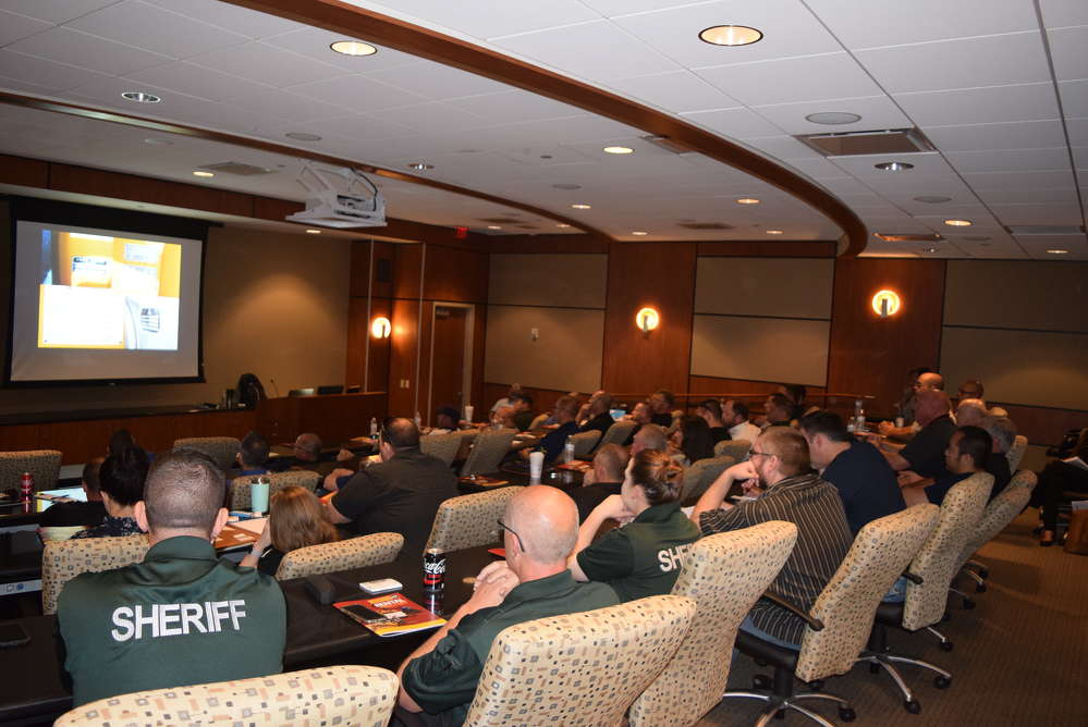 Attendees learn more about commercial heavy equipment theft.